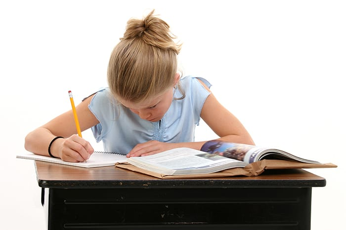 A girl working with homework